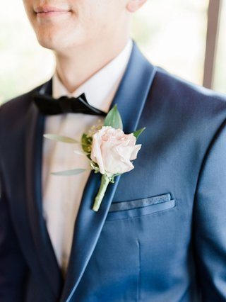 wedding-boutonniere-groom-flower-accessory-bow-tie-navy-blue-suit-jacket-boutonniere