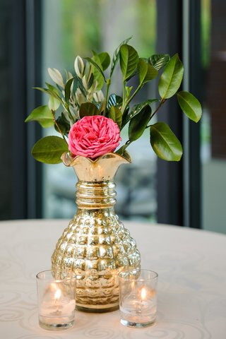 mercury-glass-vessel-filled-with-leaves-and-rose