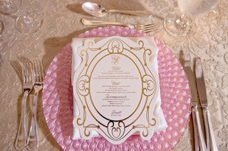 pink-charger-plate-white-menu-with-gold-border-details-and-monogram-salad-entree-dessert
