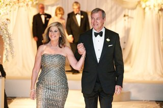 mother-of-bride-in-strapless-metallic-dress-and-father-of-bride-in-tuxedo-and-bow-tie