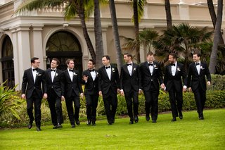 groom-and-groomsmen-in-black-and-white-tuxes-at-the-breakers-wedding-venue