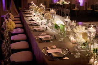 purple-lighting-at-wedding-reception-grey-linen-head-table-with-white-low-flower-arrangements-candle