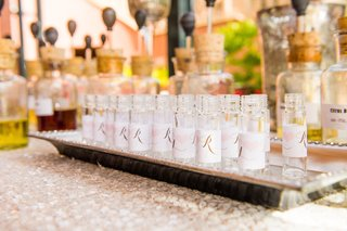 wedding-shower-with-perfume-station-bottles-with-the-couples-initials-on-labels