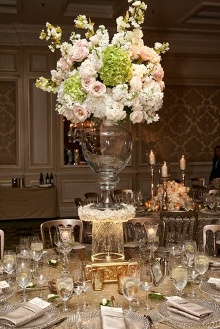 wedding-arrangement-of-pink-rose-white-hydrangea-on-top-of-glass-vase