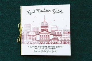 white-booklet-with-illustration-of-madison-capitol-building-as-guide-to-out-of-town-wedding-guide