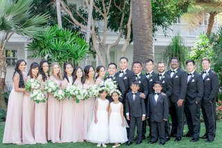 bride-and-groom-with-flower-girls-ring-bearers-bridesmaids-blush-dresses-groomsmen-suits-bow-ties