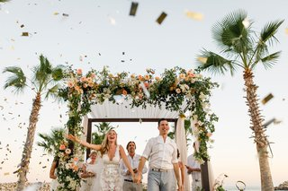 bride-and-groom-excited-after-wedding-ceremony-and-confetti-cannon