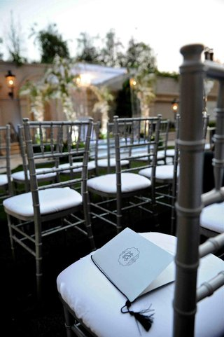 ceremony-booklet-on-alfresco-chair-cushion