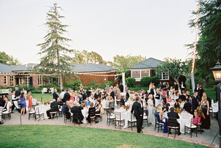 outdoor-wedding-at-brides-parents-house-with-round-tables-and-long-farm-tables