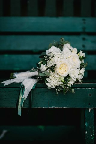 white-green-floral-bouquet-ribbons-leaves-peonies-green-bench-maine-wedding