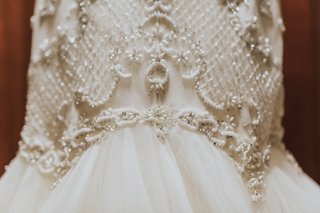detail-shot-of-beading-on-wedding-dress-by-watters