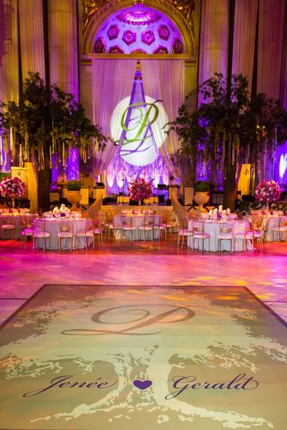 ballroom-reception-space-with-tree-and-wedding-names