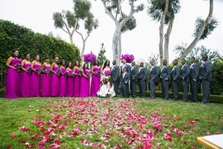 bridal-party-with-pink-dresses-and-groomsmen-in-gray-suits