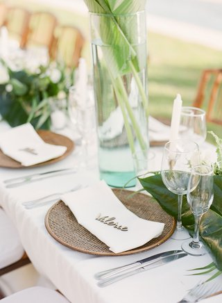 wedding-reception-in-mexico-destination-wedding-rattan-charger-plate-with-laser-cut-wood-place-card