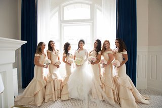 bride-in-matthew-christopher-wedding-dress-and-bridesmaids-in-off-shoulder-mermaid-gowns-gold