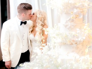 bride-and-groom-kiss-before-cake-cutting-at-wedding-reception-groom-outfit-change