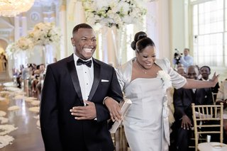 groomsman-in-black-and-white-tuxedo-with-silver-mother-of-bride
