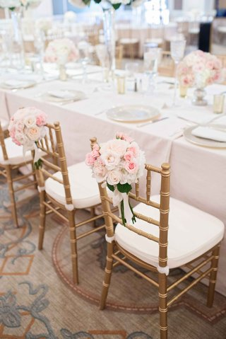 pink-white-floral-clusters-leaves-gold-chairs-light-linens-low-floral-centerpieces