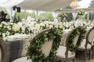 green-wreaths-back-bride-groom-chairs-sweetheart-wedding-reception-tented-outdoor-rustic-chic-unique