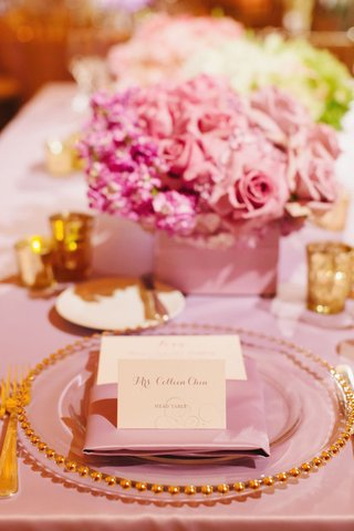 pink-tablecloth-with-pink-napkin-and-gold-rimmed-charger-plate