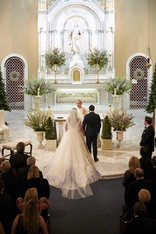 bride-in-purple-floral-romona-keveza-wedding-dress-groom-in-navy-tuxedo-catholic-church-wedding