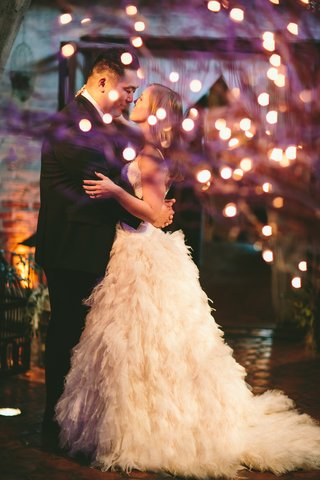 bride-in-monique-lhuillier-dress-with-groom-at-reception