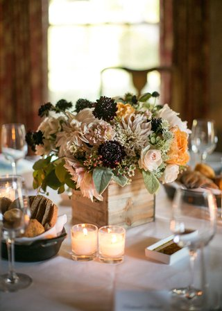ranch-wedding-centerpiece-with-pink-roses-dahlias-peach-peonies-greenery-dark-berries