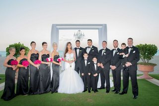 wedding-party-charcoal-grey-black-bridesmaid-dresses-groomsmen-in-tuxedos-ring-bearers-pink-flowers