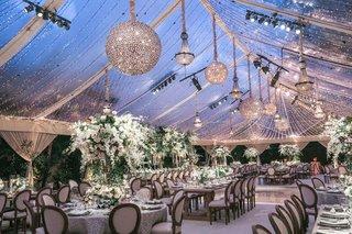 wedding-reception-tent-clear-top-chandeliers-string-lights-rustic-elegant-decor-tent-reception