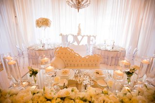 mirror-top-sweetheart-table-loveseat-flowers-candles-metallic-glass-love-table-drapes