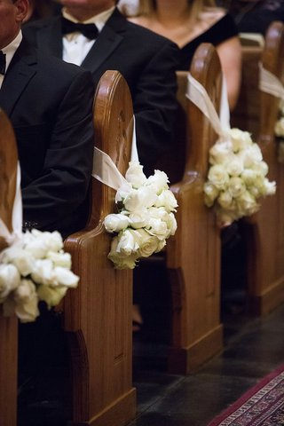 wedding-ceremony-church-decoration-ideas-white-rose-bundles-on-church-pews-wood-white-ribbon