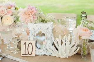 antique-white-frame-with-coral-and-wooden-table-number