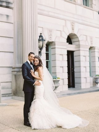 wedding-in-washington-dc-wedding-planner-bride-and-handsome-groom-in-tuxedo-mermaid-dress-carines