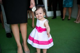 precious-toddler-flower-girl-in-white-and-pink-dress-with-white-flower-headband