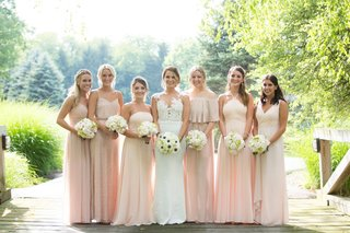 bride-in-pronovias-gown-with-illusion-neckline-lace-bodice-mismatched-bridesmaids-in-blush