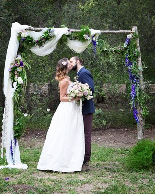 outdoor-wedding-ceremony-at-the-oak-canyon-ranch-with-a-wood-arch-white-fabric-garlands-of-flowers