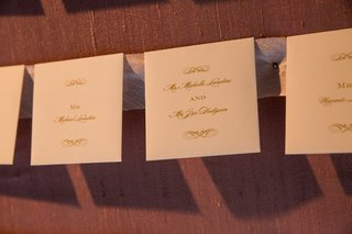 formal-escort-cards-for-wedding-ivory-paper-and-gold-print