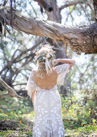 bohemian-bride-in-detailed-wedding-dress-with-open-back-and-head-garland-in-santa-barbara-forest