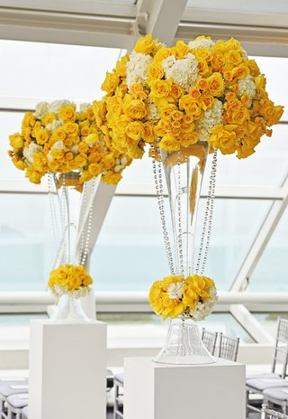 wedding-ceremony-at-the-adler-planetarium-with-yellow-roses-tulips-and-white-hydrangeas-in-trumpet