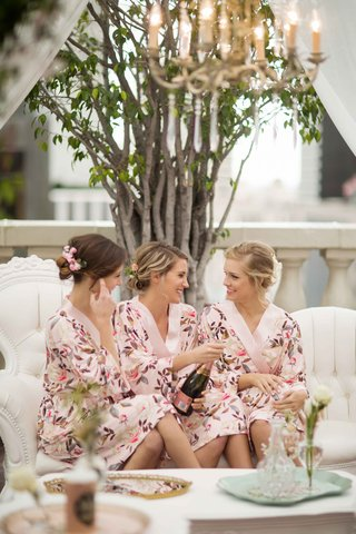 bridesmaids-in-floral-robes-popping-pink-champagne