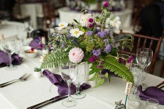 wedding-reception-lyndsy-fonseca-and-noah-bean-ferns-purple-flowers-purple-napkin-wood-chair