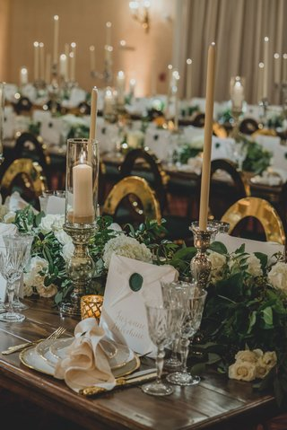 wedding-reception-wood-table-with-greenery-white-flower-tall-taper-candle-antique-style-wax-seal