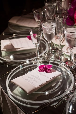 wedding-reception-table-mirror-tabletop-clear-charger-plate-single-orchid-blooms-silver-rim-glass
