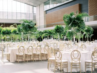 cleveland-museum-of-art-wedding-reception-tropical-greenery-heatherlily-gold-chairs-modern-look
