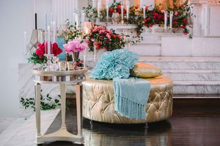 gold-ottoman-wedding-reception-lounge-area-pink-blue-details-leaves