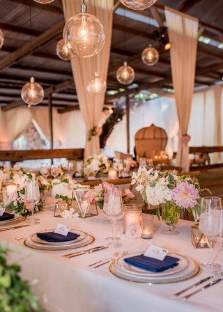 barn-wedding-reception-u-shape-table-gold-terrarium-geometric-glass-orb-pendants-pink-dahlia-flowers