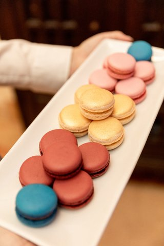 white-narrow-tray-with-teal-rust-champagne-and-pink-macarons
