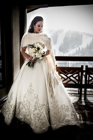 bride-wearing-furry-shawl-and-embroidered-gown
