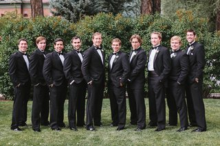 groom-with-groomsmen-on-lawn-in-tux-and-bow-tie