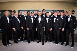 black-and-white-tuxedo-with-bow-tie-groomsmen-outfits